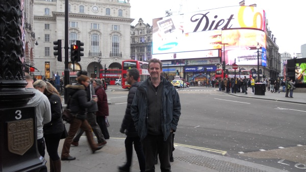 Stuart in Piccadilly Circus. What's with the hidden messages? Am I getting fat?
