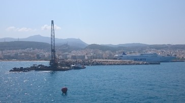 Dredger hard at work clearing the harbour entrance, Rethymno