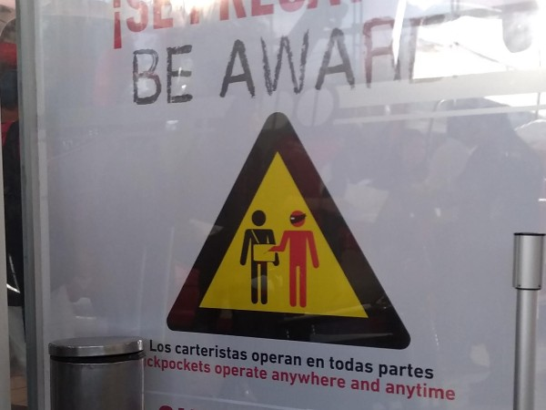 I love this pickpocket warning sign at the bus station