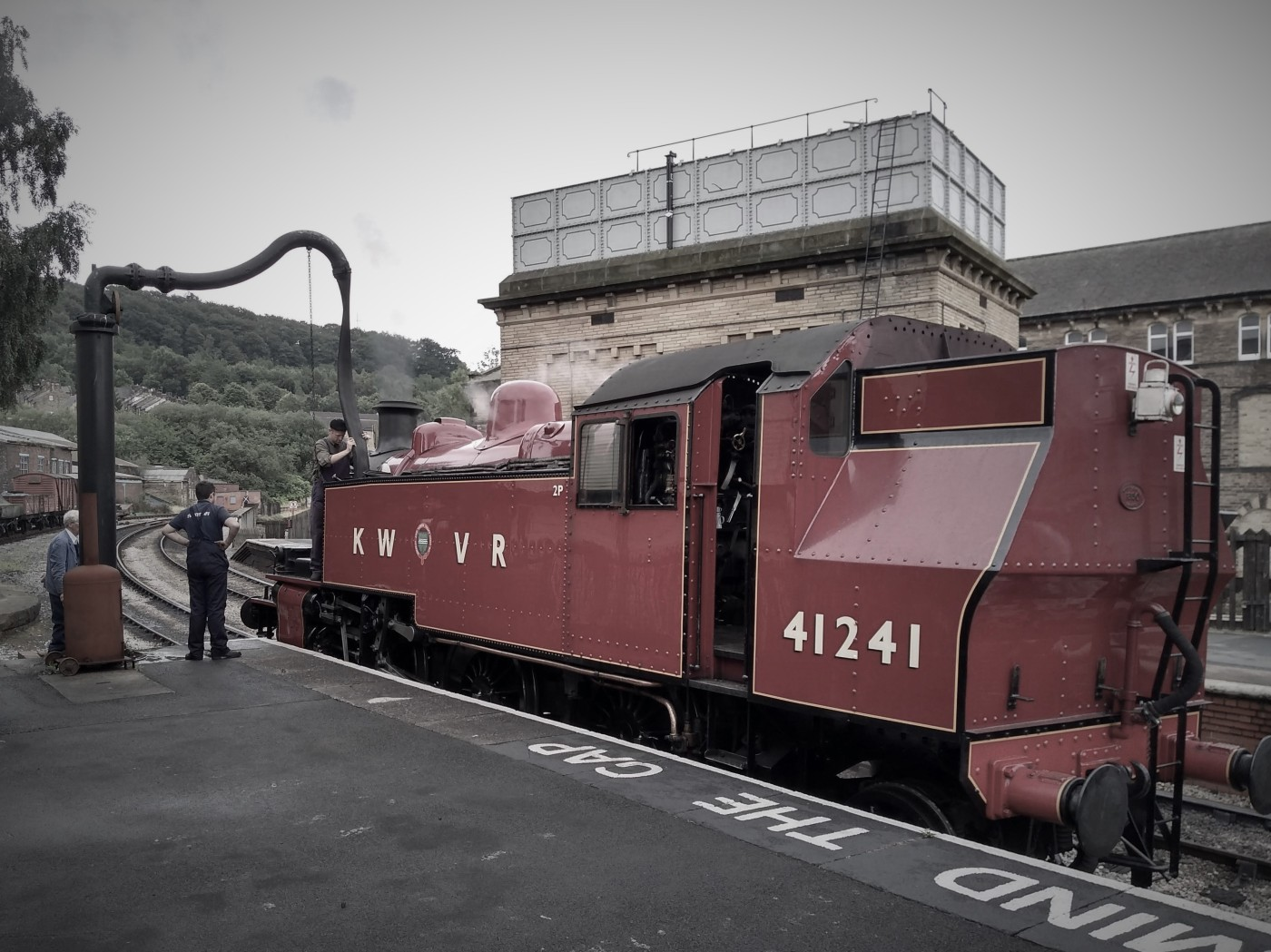 Ivatt 2MT taking on water at the end of platform 3, Keighley
