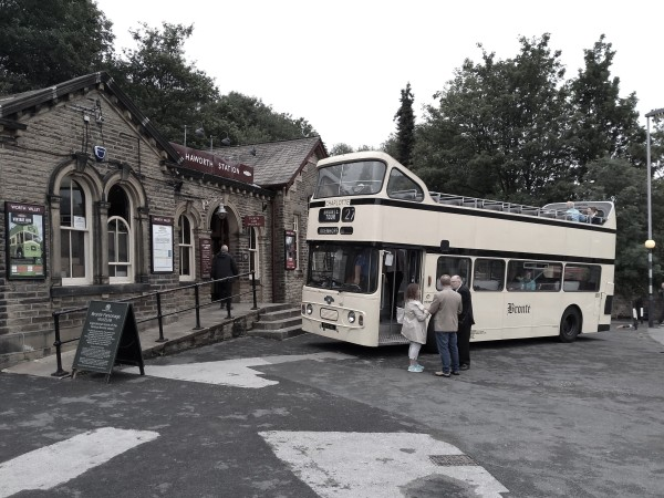 Vintage bus tour outside Haworth station